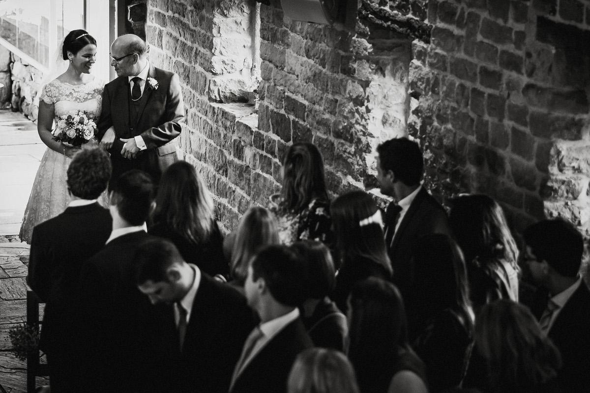 bride and dad entering ceremony room