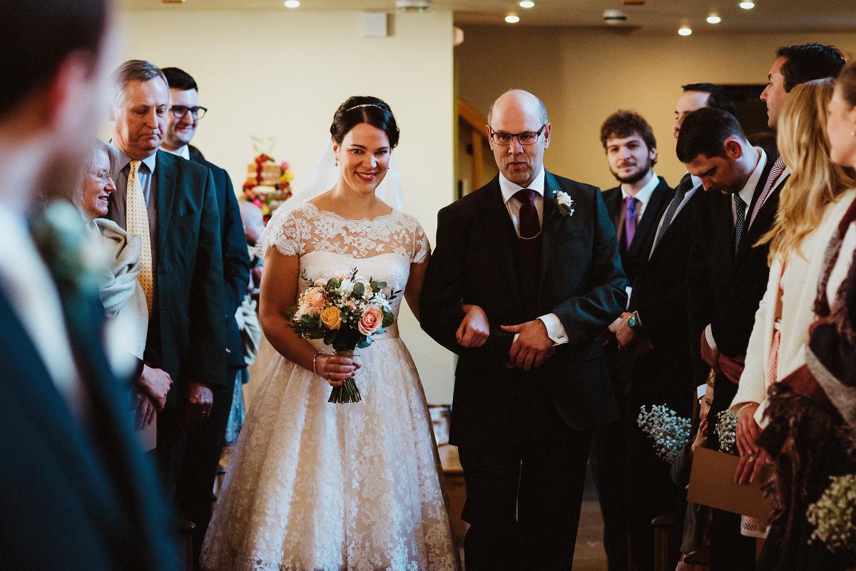 bride and dad walk up aisle