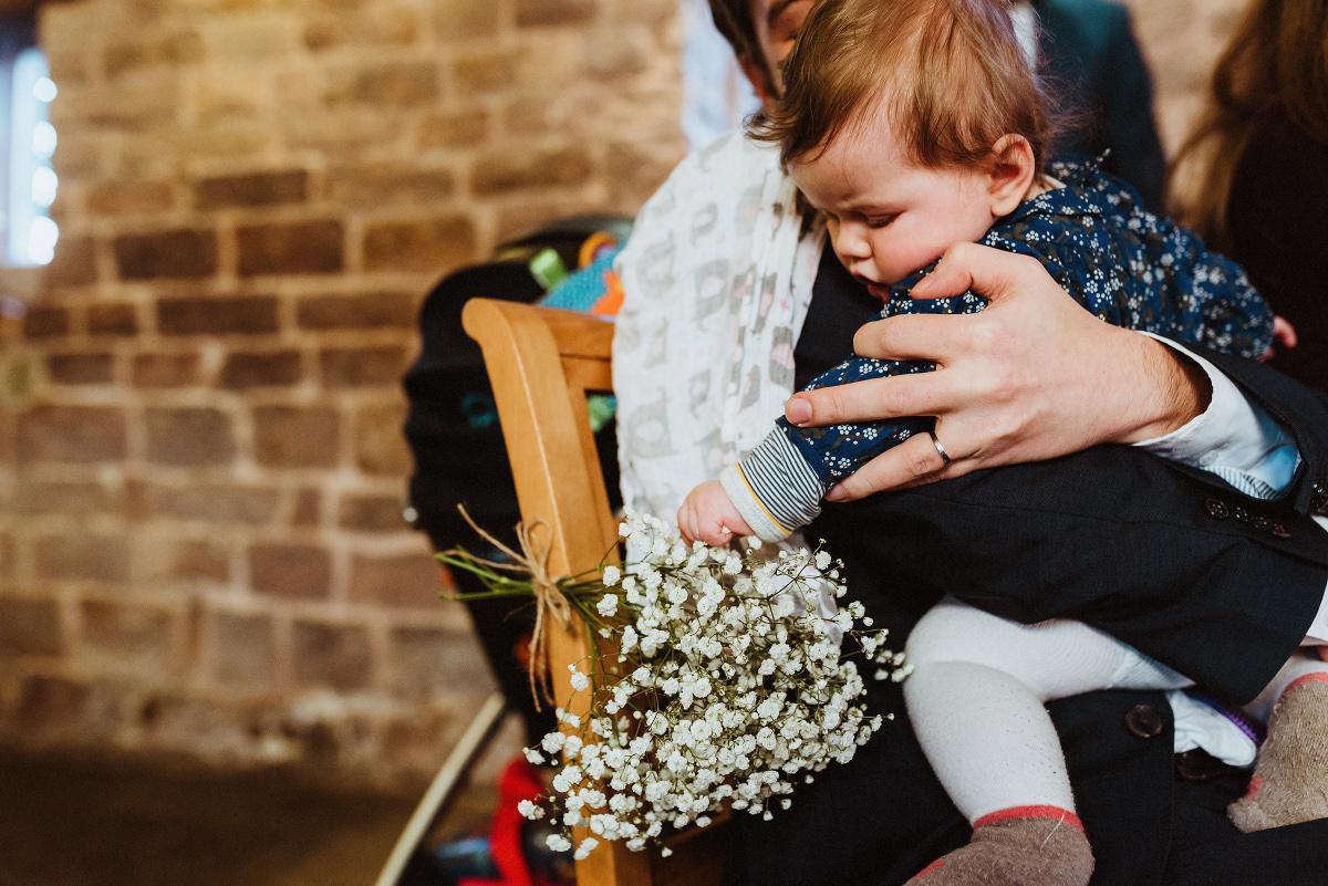 baby grabs bouquet