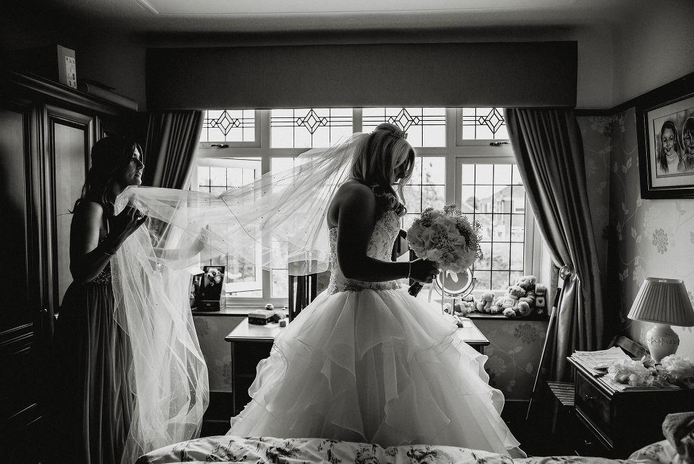 bride puts on her veil
