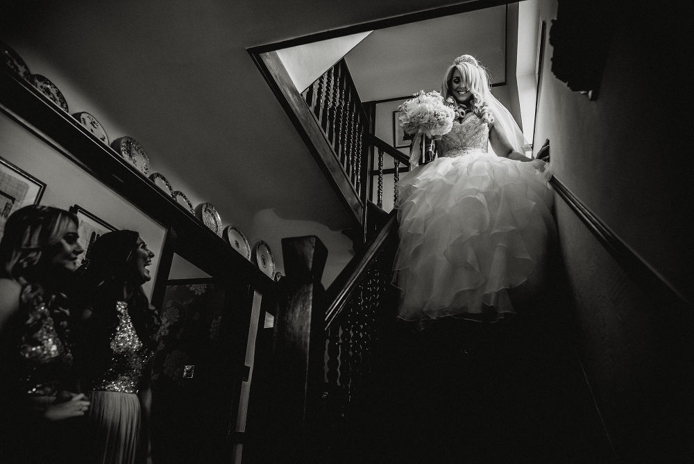 bride comes down stairs