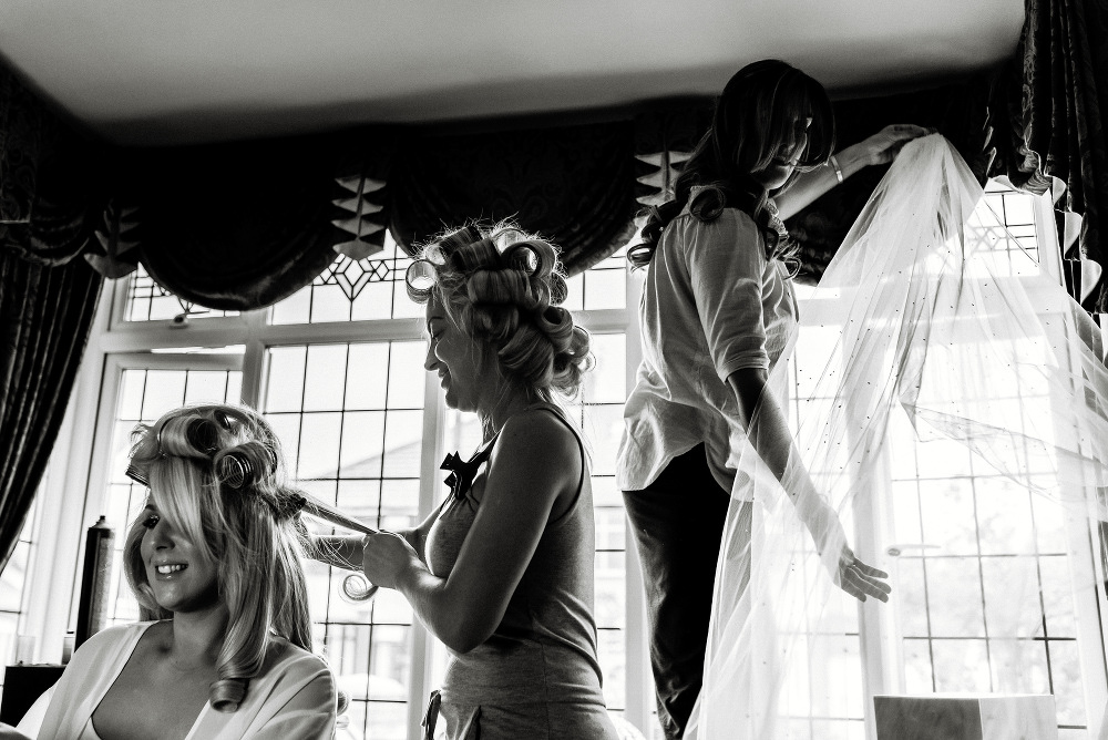wedding veil hangs in window