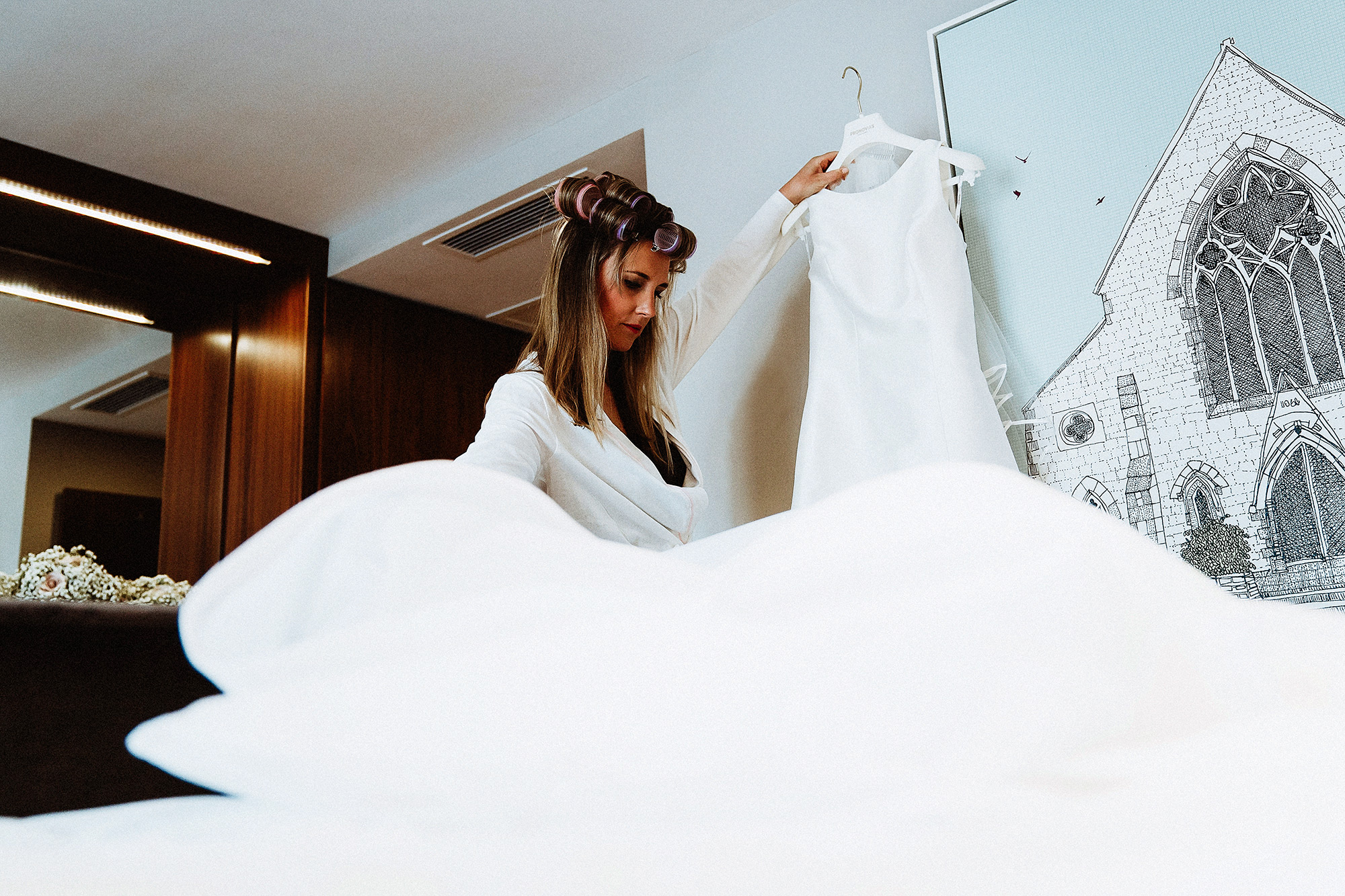 Bride unwraps wedding dress